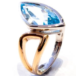 Unusual Rose and White Gold Ring with Blue Topaz