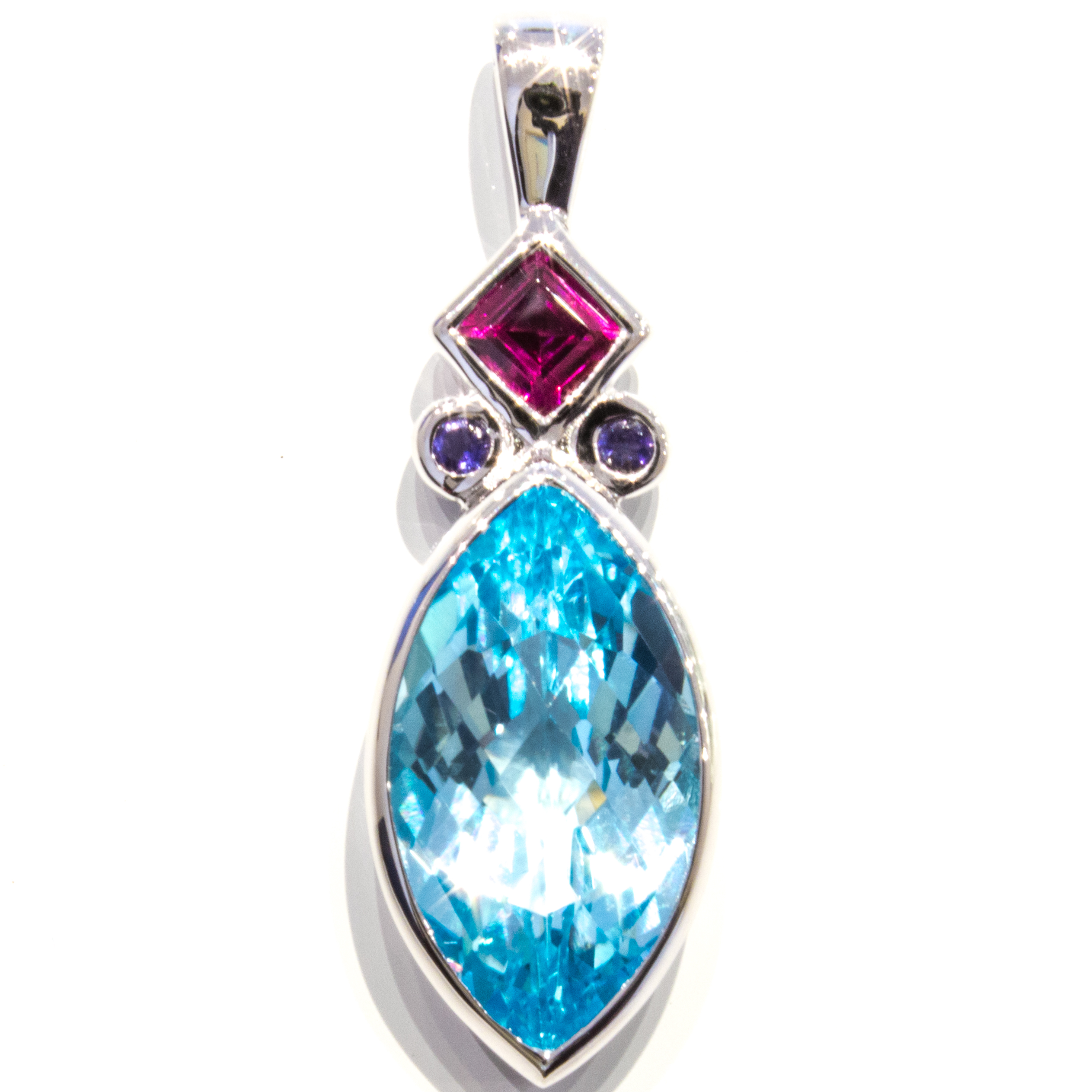 Blue Topaz, Garnet and Iolites Pendant